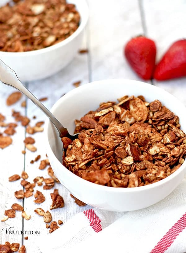 chocolate granola in white dish with spoon