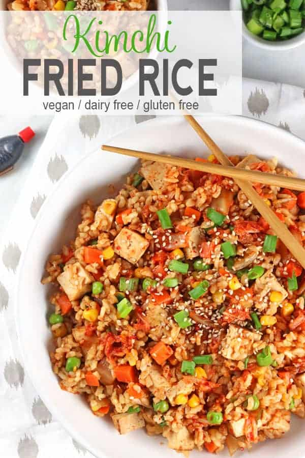 Kimchi Fried Rice | This Vegan Kimchi Fried Rice adds a pop of flavor to a traditional dish.  The rice is not actually fried and it uses no oil so it's a healthy quick meal on busy nights. It's also vegan, gluten-free, fish-free, and comes together in about 15 minutes! #veganfriedrice #healthyfriedrice #vegankimchifriedrice  #vegankimchi #easyvegandinner #vnutrition