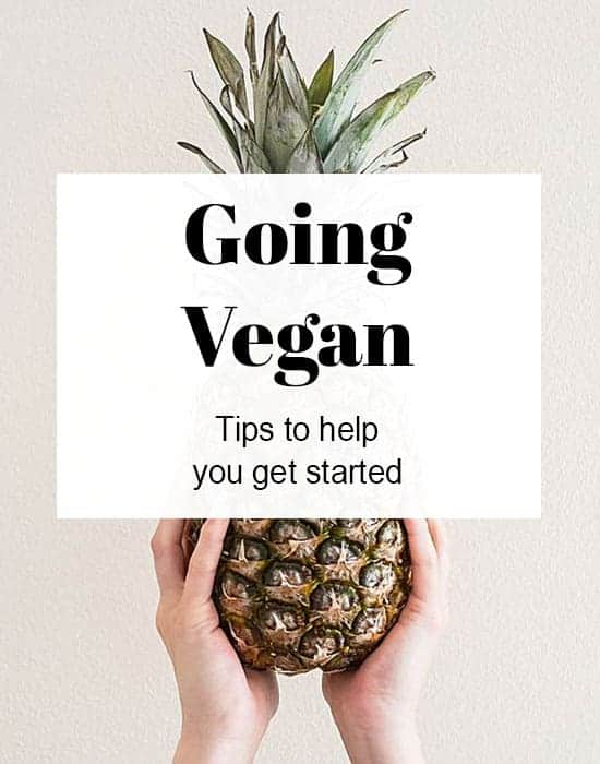 How to Go Vegan text with someone holding a pineapple in the background