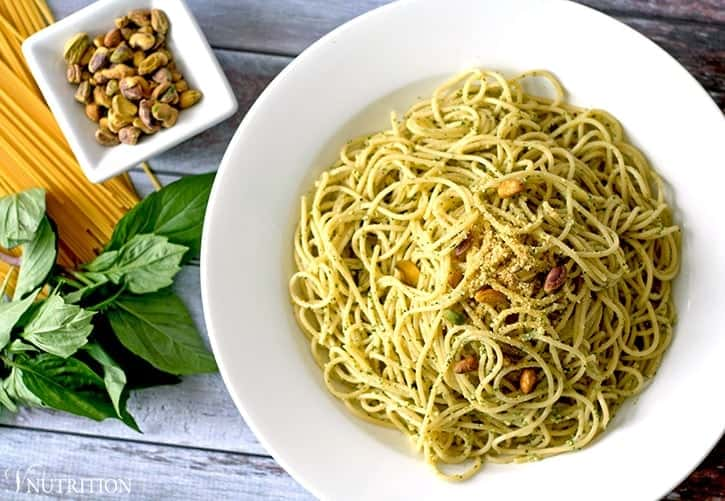 Vegan Pistachio Pesto |This vegan pistachio pesto is a healthy twist on traditional pesto using less oil and switching pine nuts for pistachios. | Check out the recipe or pin for later!