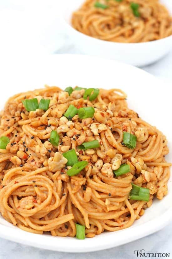 closeup of Spicy Sesame Noodles with bowl of noodles in background