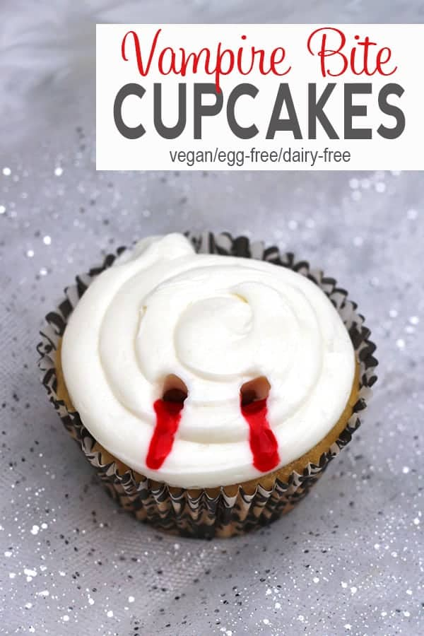 Vampire Bite Cupcakes are perfect for Halloween or watching your favorite scary movies! These vegan cupcakes are filled with strawberry jam to scare everyone that takes a bite! Check out how to make them at VNutrition! #veganhalloween #veganhalloweenrecipes #vegancupcakes #veganhalloweencupcakes #vampirebitecupcakes #vnutrition