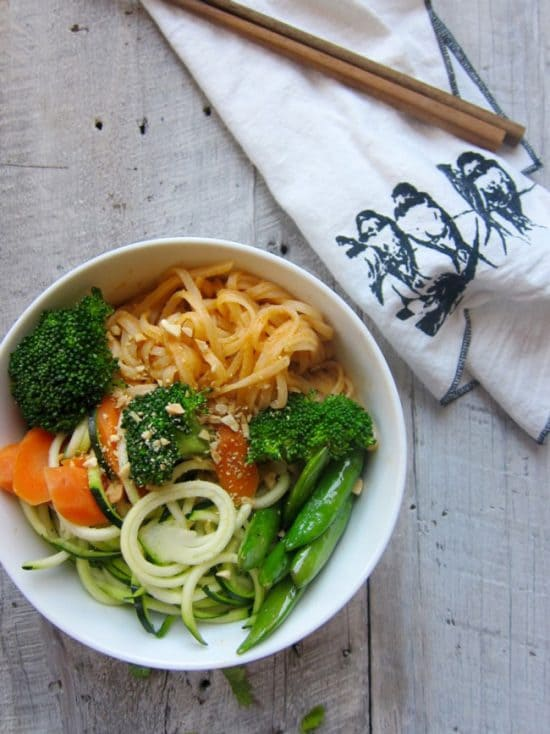 red curry noodle bowl with chopsticks and napkin