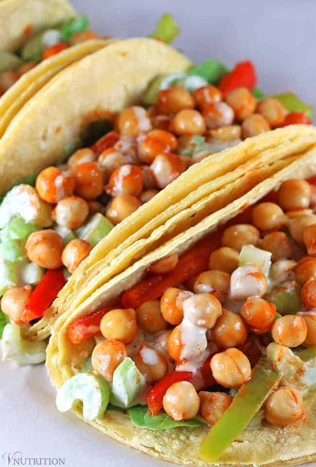 closeup of buffalo chickpea tacos with ranch sauce