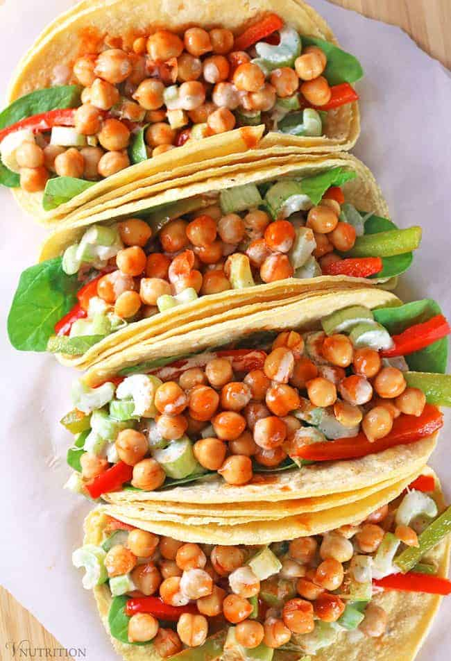 overhead shot of buffalo chickpea tacos on cutting board
