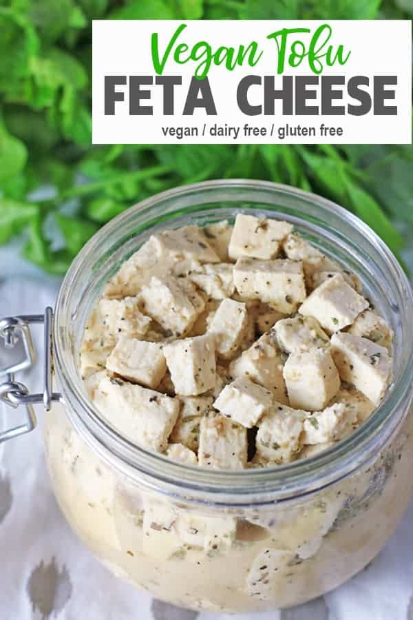 Tofu Feta | This vegan Tofu Feta is a perfect snack on its own or crumbled into salads or on sandwiches. This healthy vegan feta cheese is marinated in almond milk, apple cider vinegar and spices for that tangy flavor. It's dairy-free, gluten-free and totally tasty! #veganfeta #vnutrition #tofufeta #vegantofufeta #tofufetarecipe  #tofufetacheese #veganfetacheese
