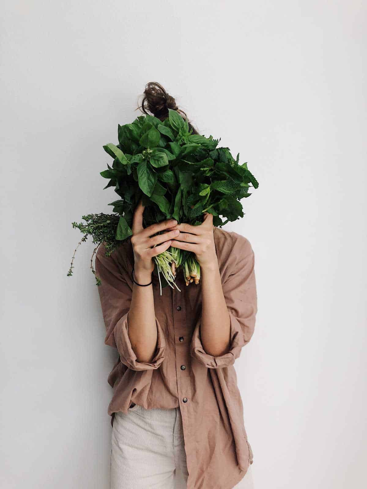 woman behind greens