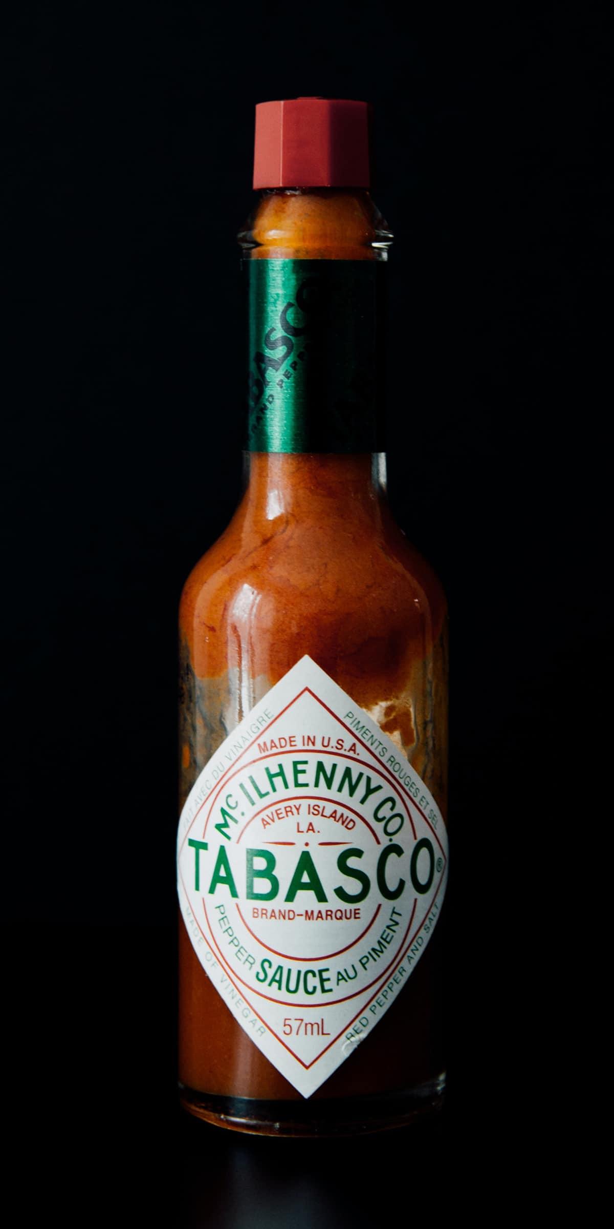 bottle of tabasco sauce with dark background