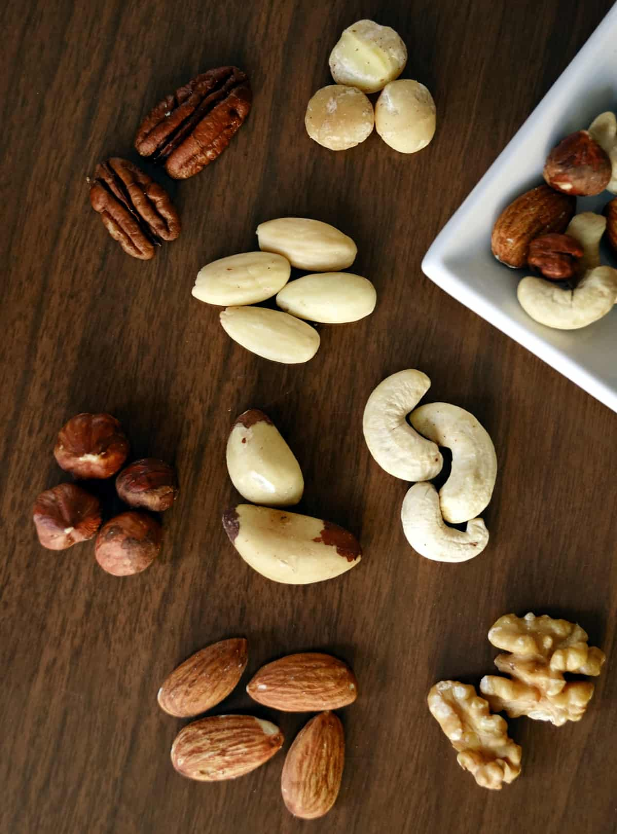 selection of nuts on a wooden table