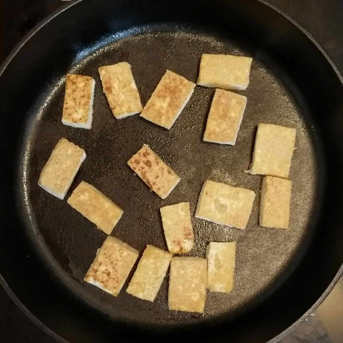 frying tofu in cast iron skillet