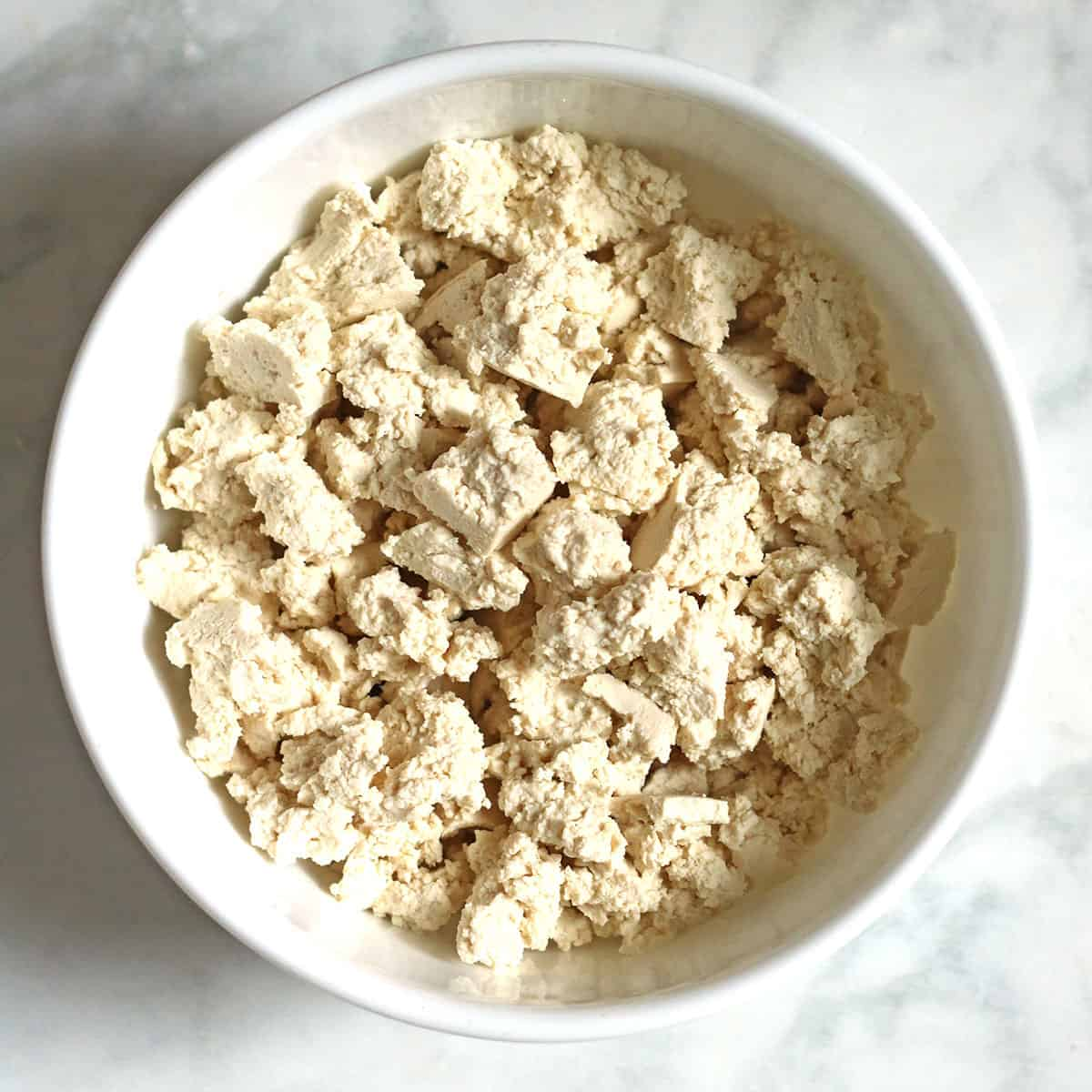 crumbled tofu in white bowl