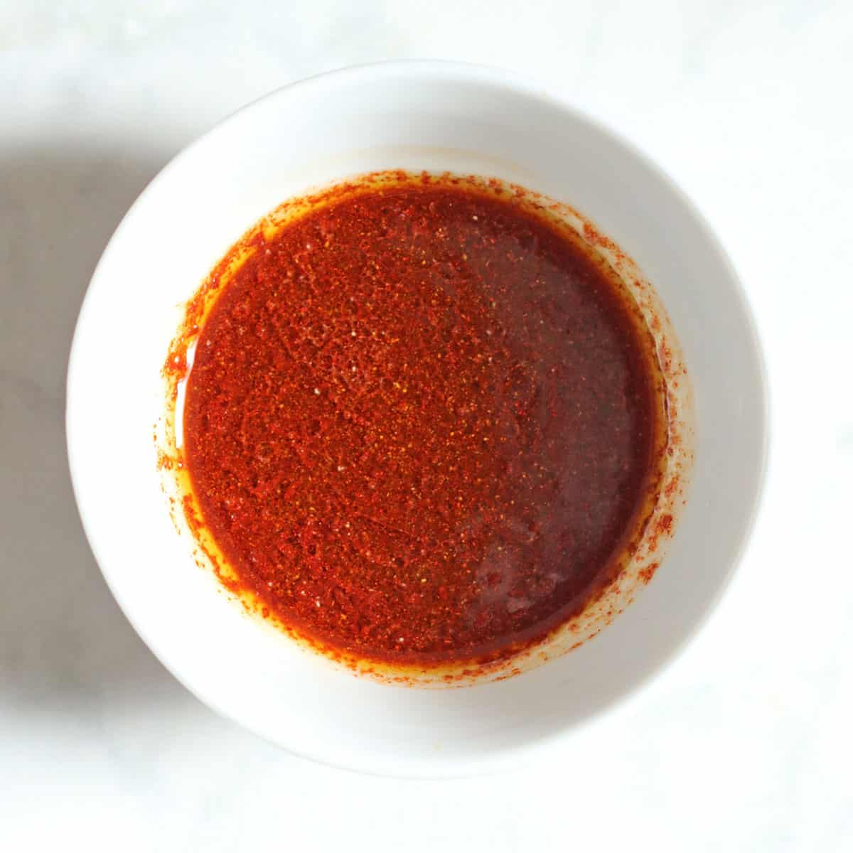 seasoning sauce in white bowl