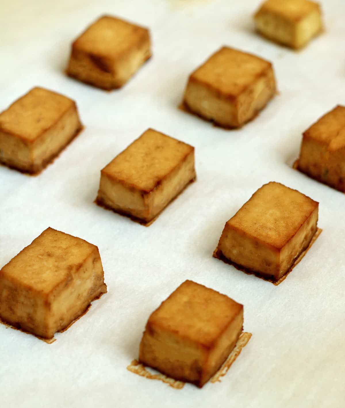 tofu baking on parchment paper