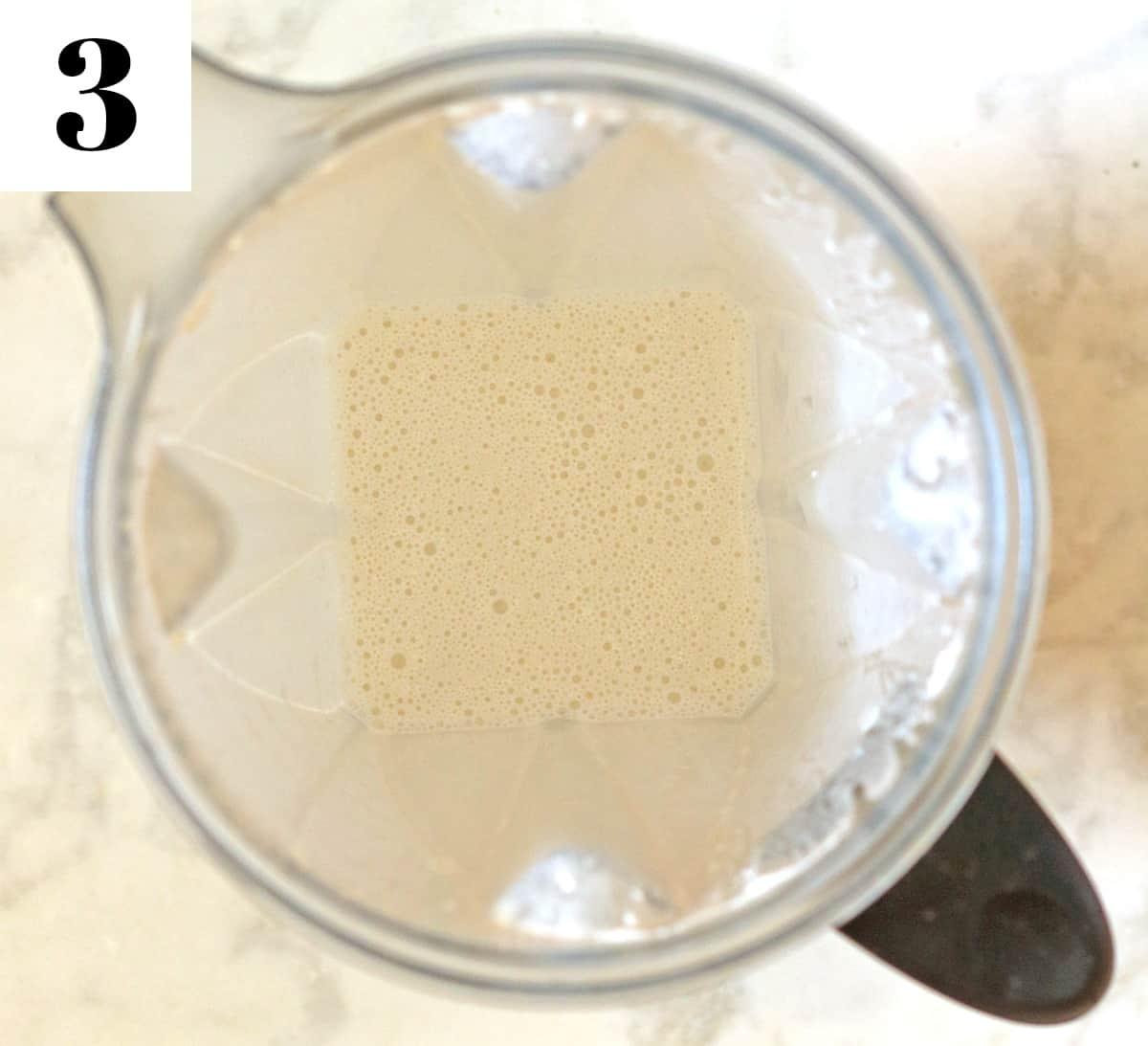 blended cashew cream in blender