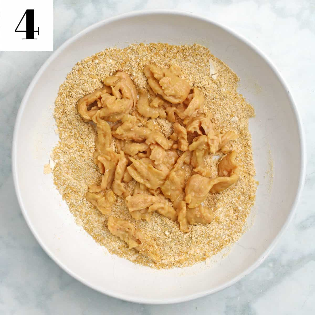 soy curls and breading in a white bowl