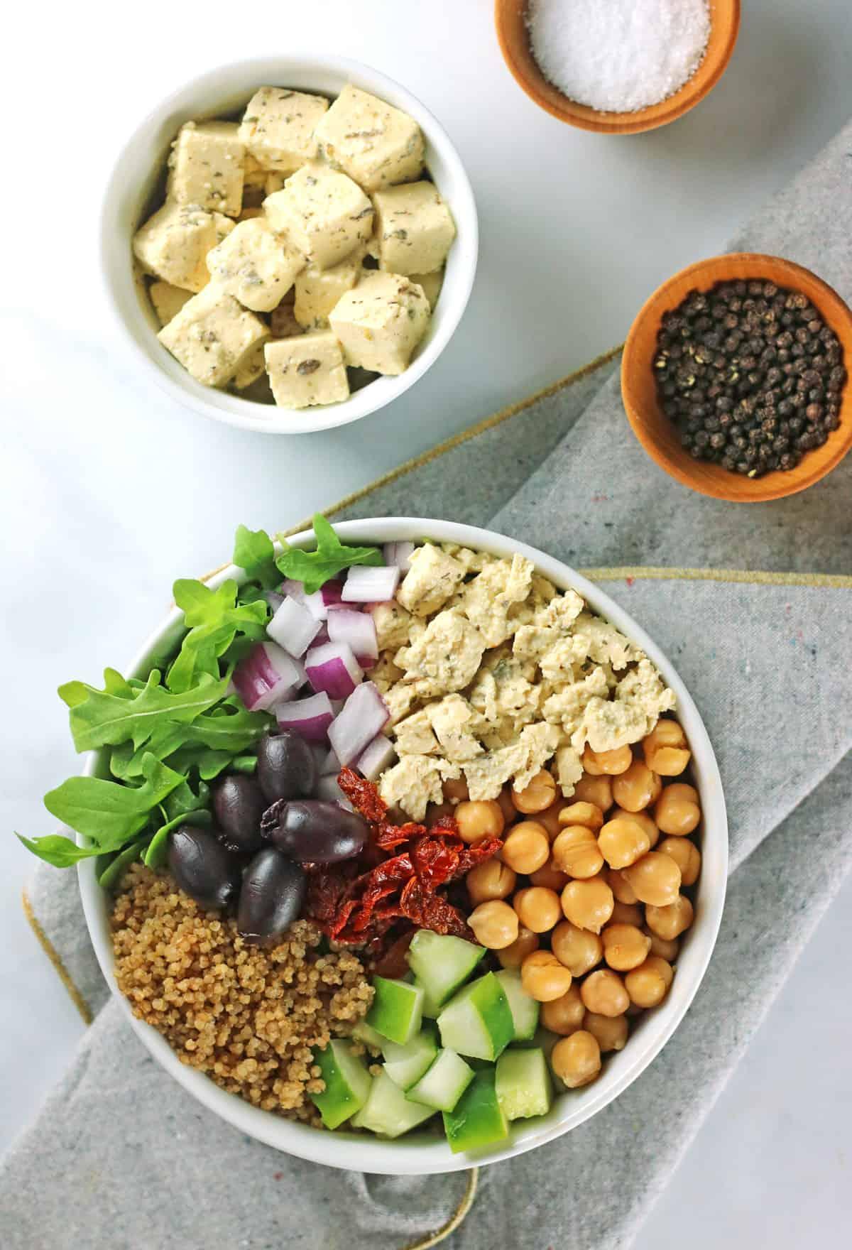 mediterranean greek quinoa salad with tofu feta and black peppercorns