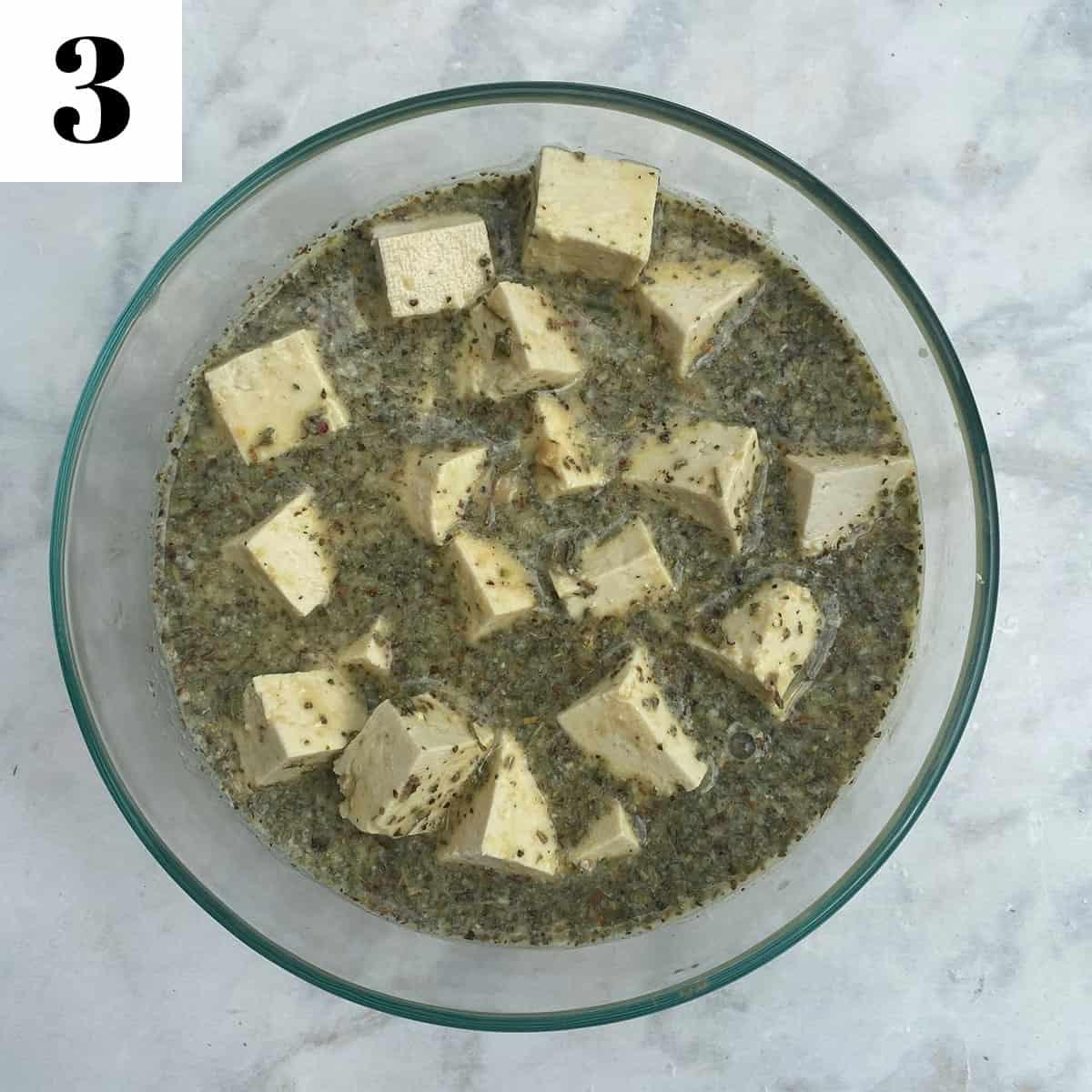 marinating tofu feta in glass bowl