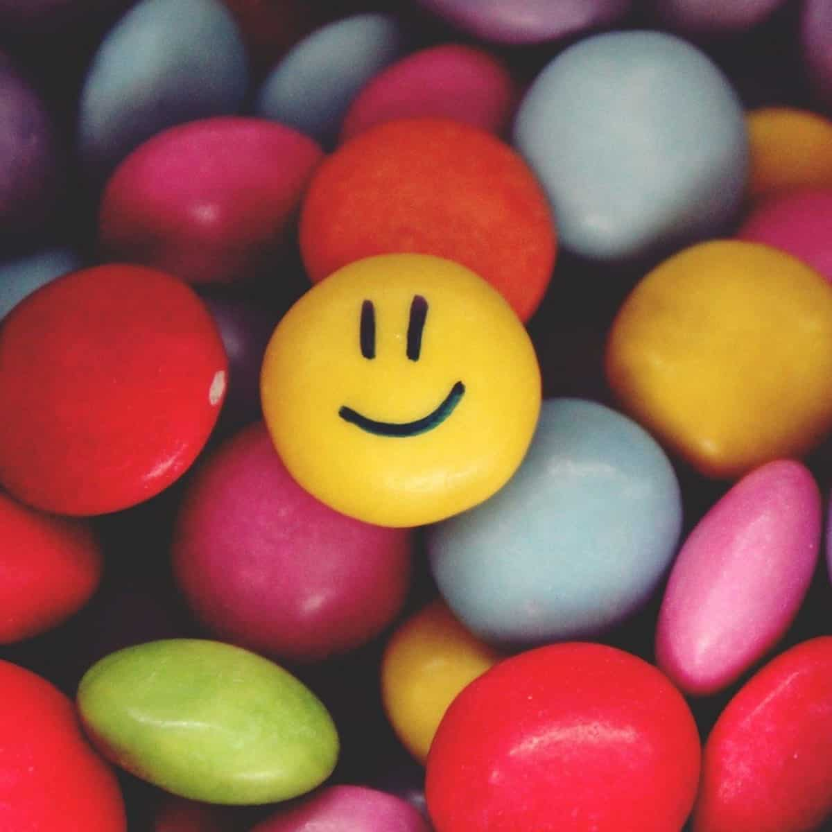 colorful round candy with smiley face on one