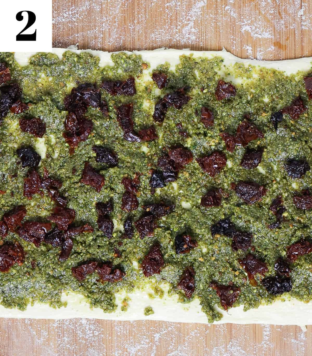 crescent roll sheet with pesto and sun dried tomatoes